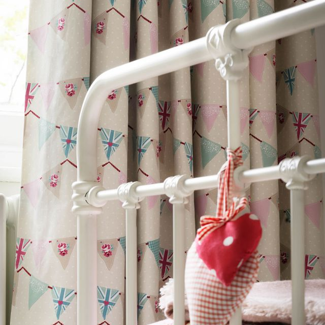 Close up of bunting chintz curtains in children bedroom