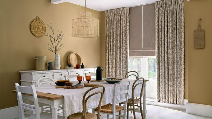 Delizia Taupe curtains and Lindora Linen romans in the dining room