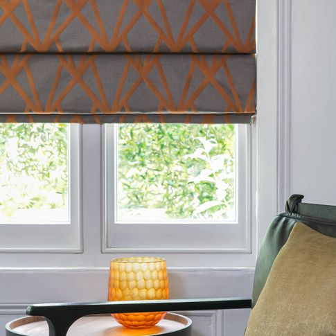 Close up of Dimension Ember roman blinds in living room