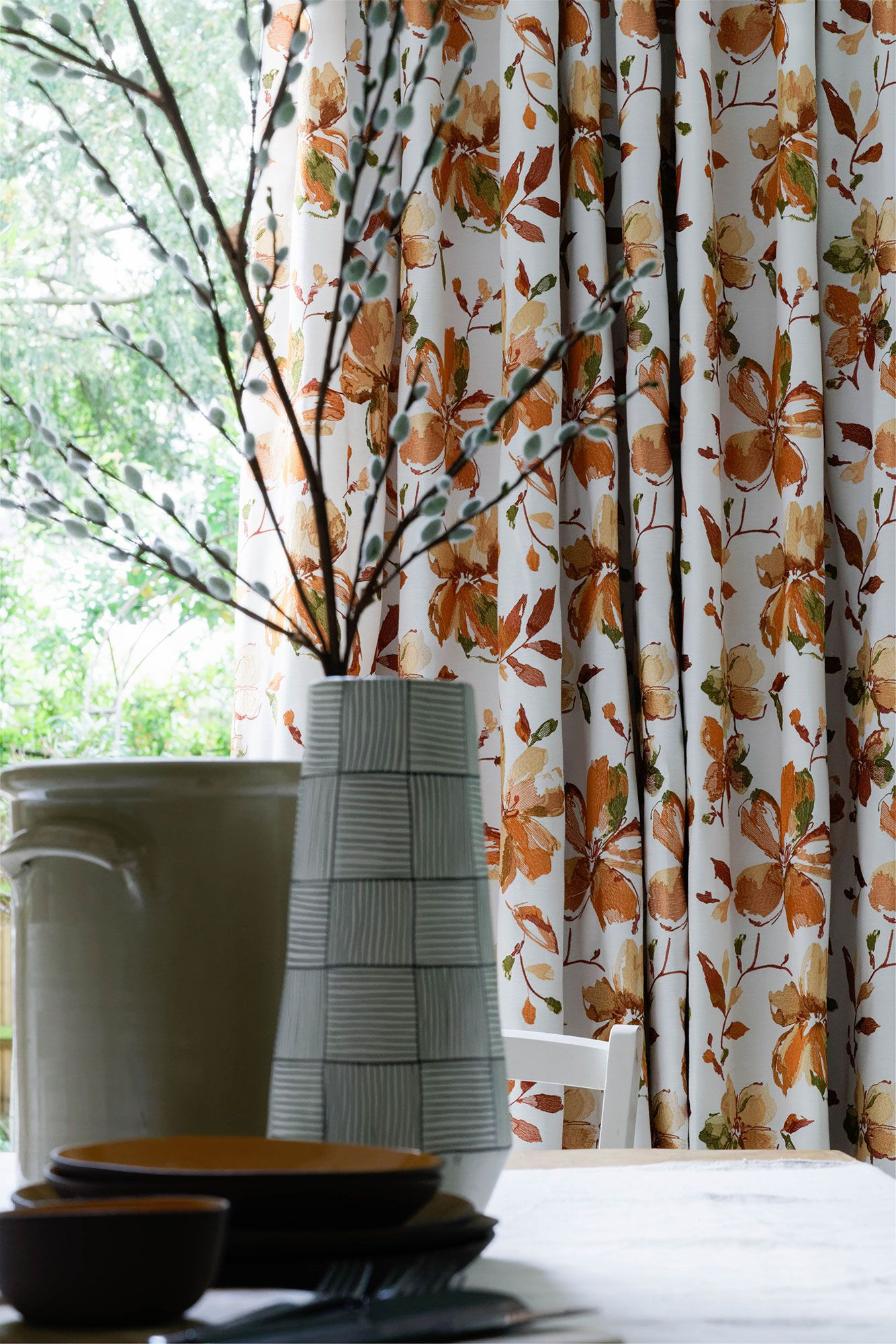 Close up of Forenza Apricot curtains in dining room