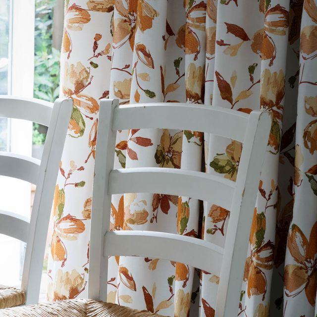 close up Forenza Apricot curtains in dining room