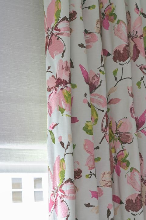 Close up of a Forenza Rose curtain Islita Ice over a White Romans in bedroom