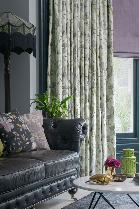 Close up of Forenza Sterling curtains Clarence Mauve romans in living room