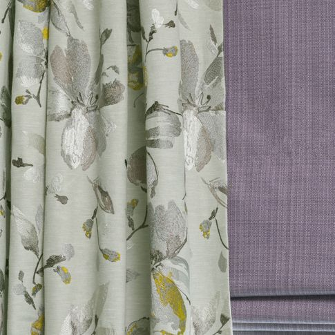 Close up of Forenza Sterling curtains Clarence Mauve Roman blind in living room