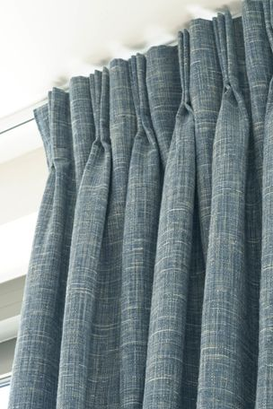 Close up detail of triple pinch pleat header style on Haddie Ocean curtains