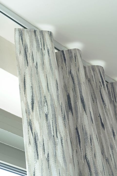 Close up detail of Impression Smoke curtains with a wave header style