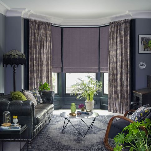 Infinity Lilac Grey curtains and Clarence Mauve romans in the living room