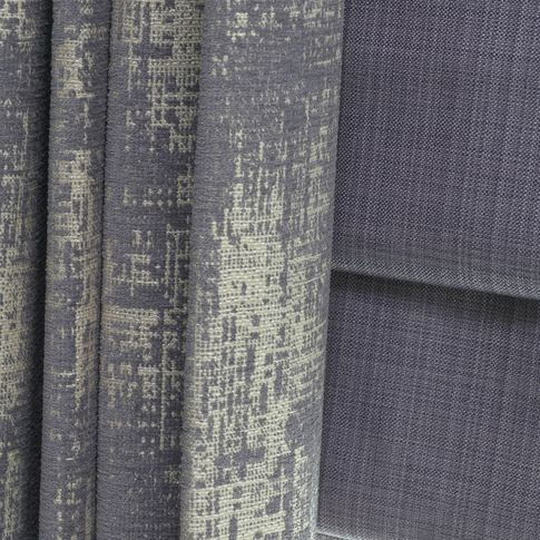 Close up of  Infinity Lilac Grey curtains and Clarence Mauve romans in the living room