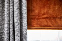 Close up of Jagger Denim curtains and Malone Cointreau Roman blinds