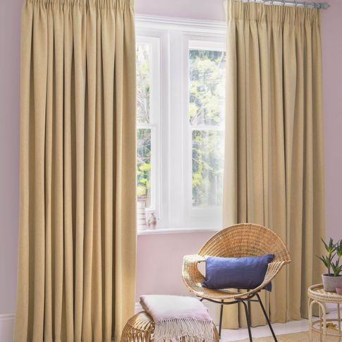 Kendra Maize curtains at wide window in bedroom