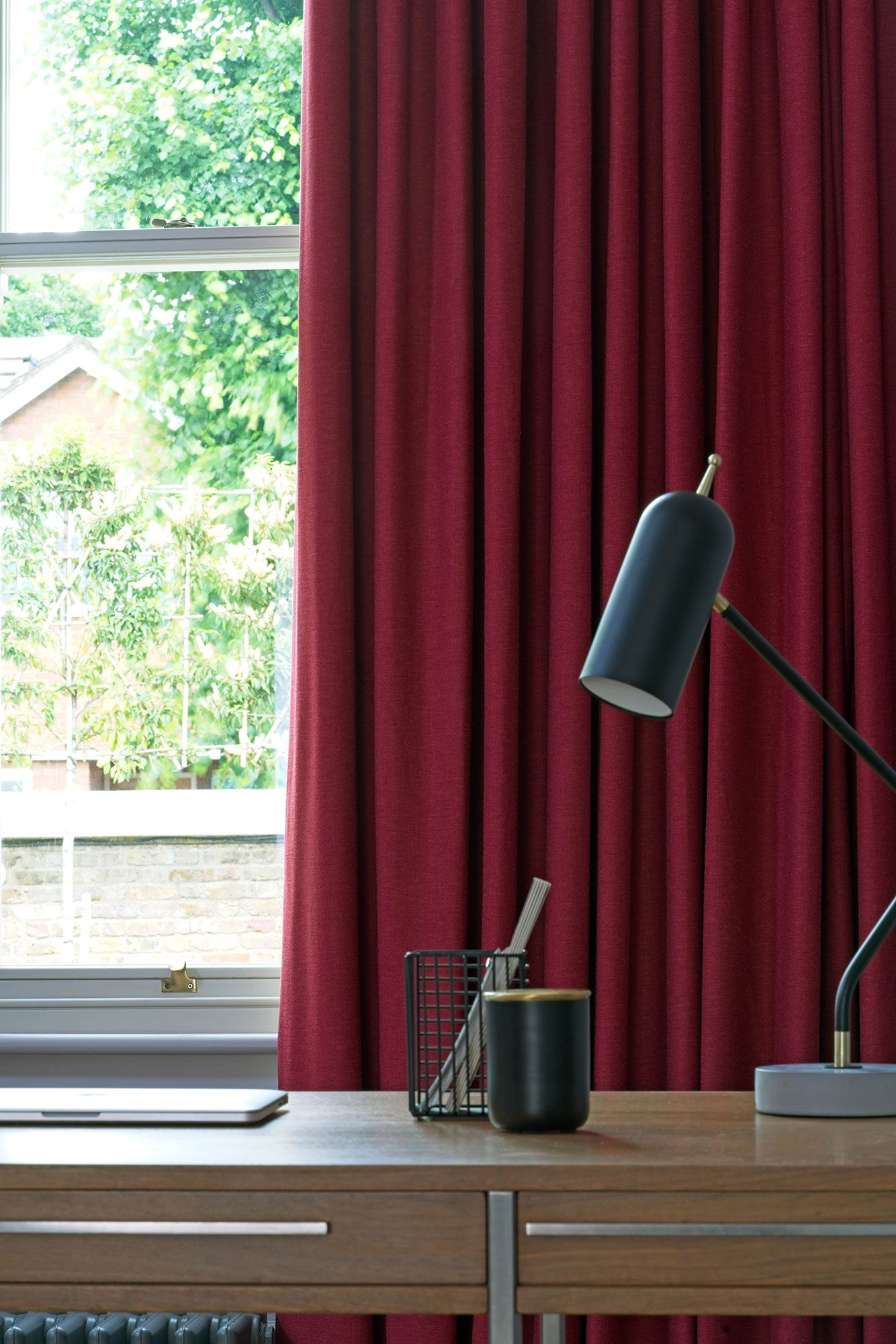 close up of Lindora Ruby curtains in office