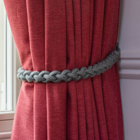 Close up detail of Lindora Ruby curtains with grey rope tie-back