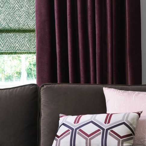 Close up of Lyon Merlot curtains and Jagger Everglade romans in living room