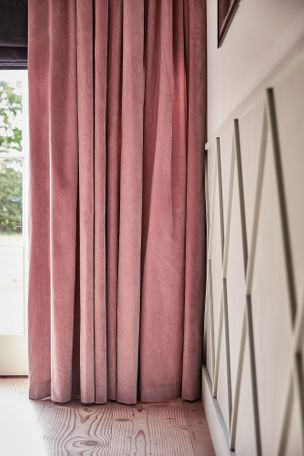 Malone Rose curtains and Allure Midnight romans in living room