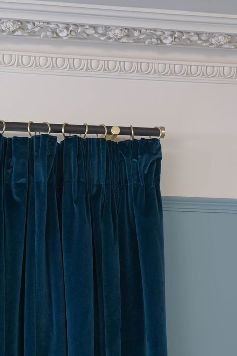 Close up of Malone Teal curtains with a pencil pleat header