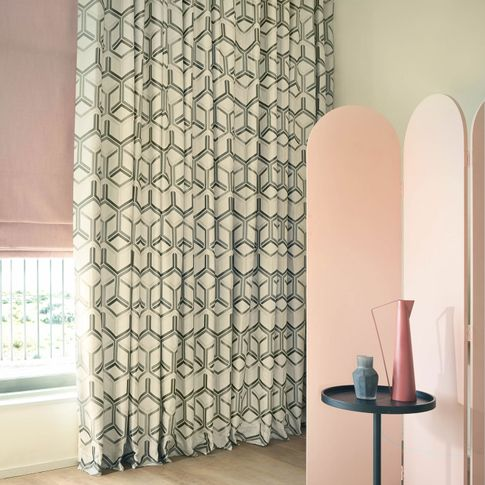Metro Pewter curtains and Bailey Taffy romans in living room