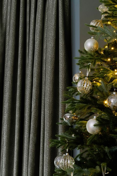 Daze Silver curtains next to christmas tree in dining room