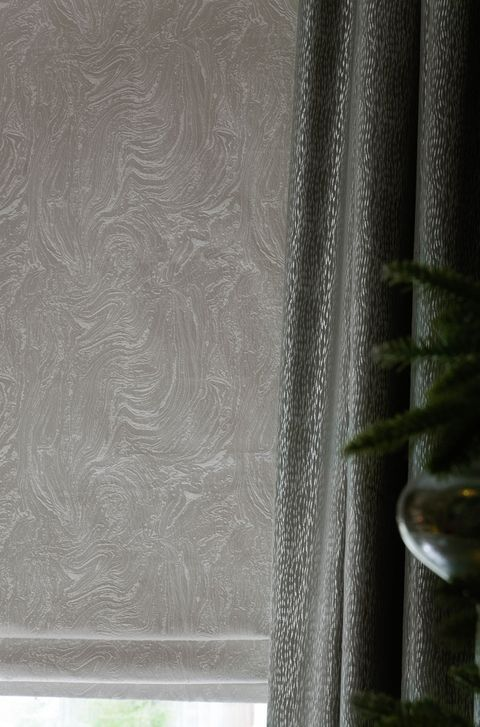 Close up of Muse Pearl curtains and Daze Silver roman blinds in dining room