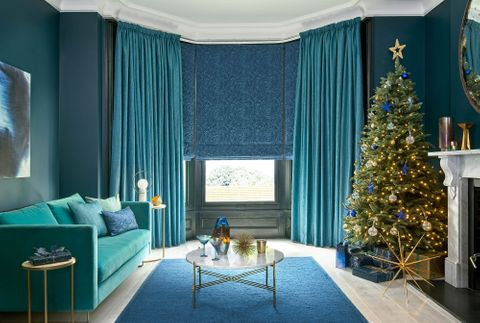 Surface Peacock curtains and Muse Deep Lapis romans in the living room decorated for chritsmas