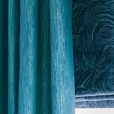 Close up of Surface Peacock curtains and Muse Deep Lapis romans in living room