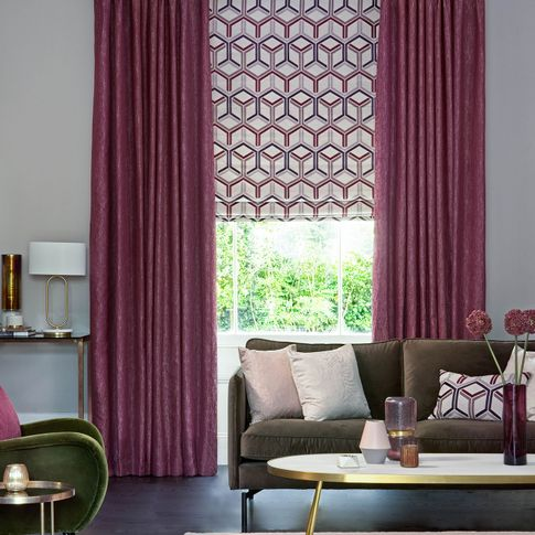 Surface Port curtains and  Metro Maroon romans and cushions on sofa in the living room