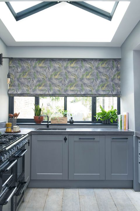 Grey and green leaf print inspired Roman blinds in a grey kitchen