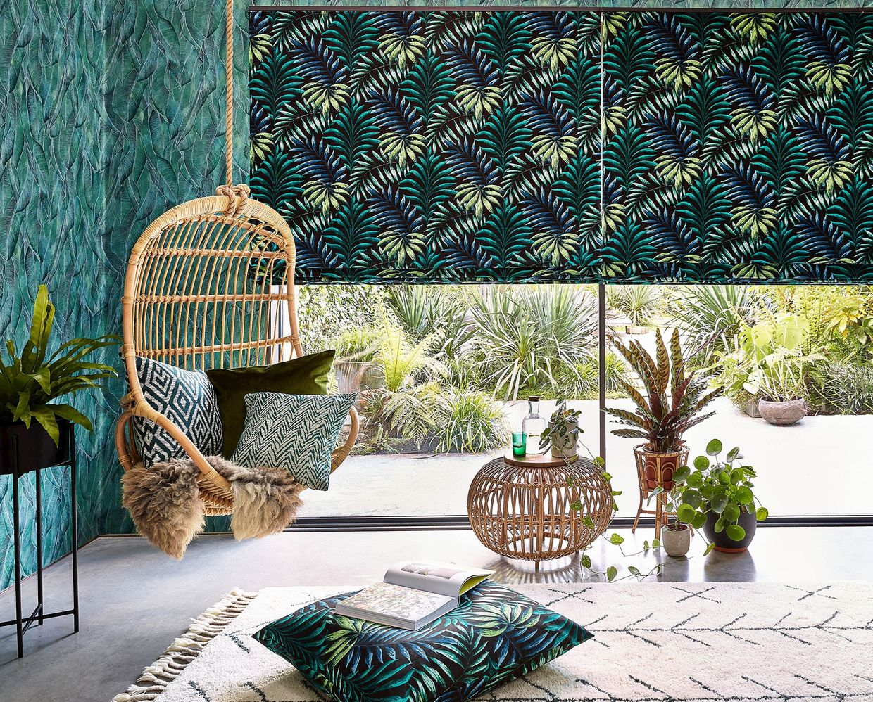Green and yellow  printed roman blinds, patterned and printed cushions on leisure hanging chair