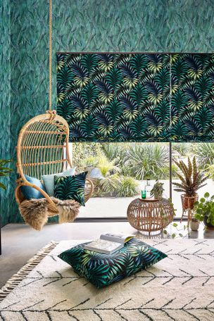 Green and yellow  printed roman blinds on patio, patterned and printed cushions on leisure hanging chair