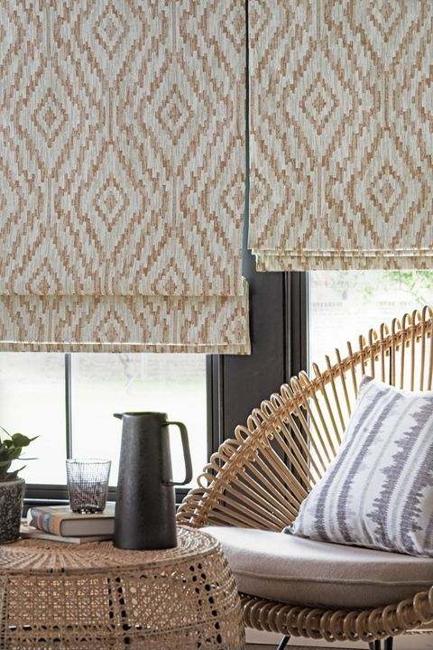 Cream brown patterned roman blinds in garden room