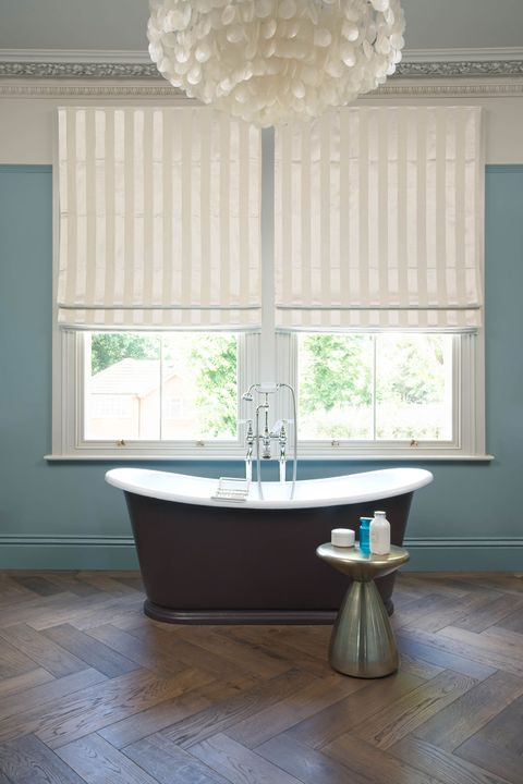 Pearl and cream stripy Roman blinds in a bathroom