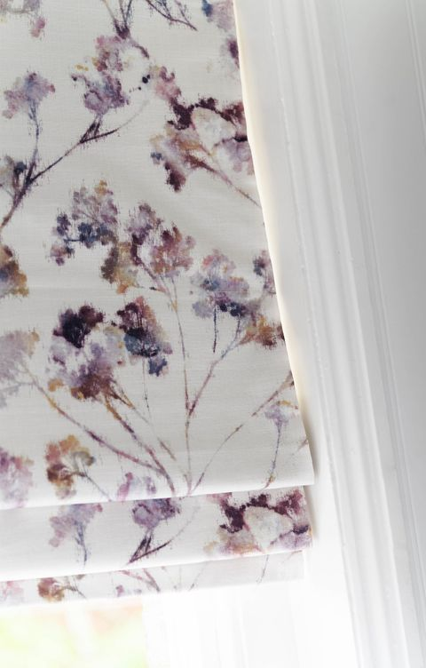 Close up of white floral printed Roman blinds