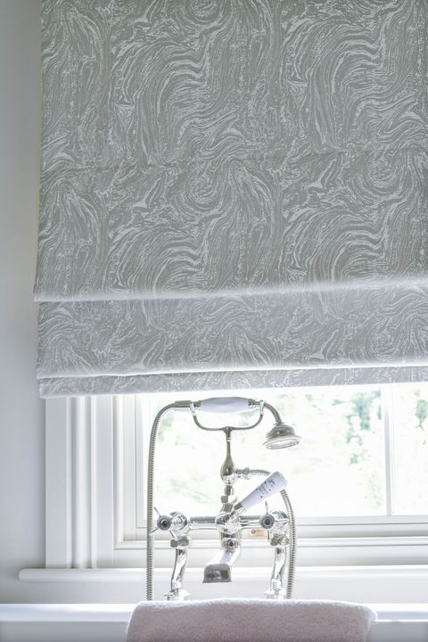 Close up of Siver marble effect Roman blinds in a bathroom