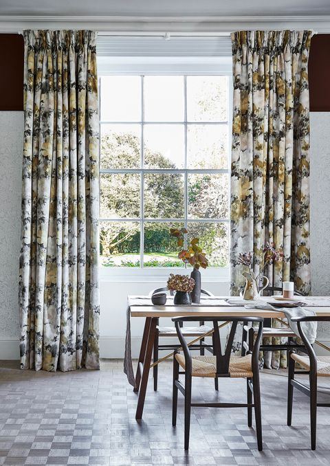 Dining room with Georgian windows and brown floral velvet curtains