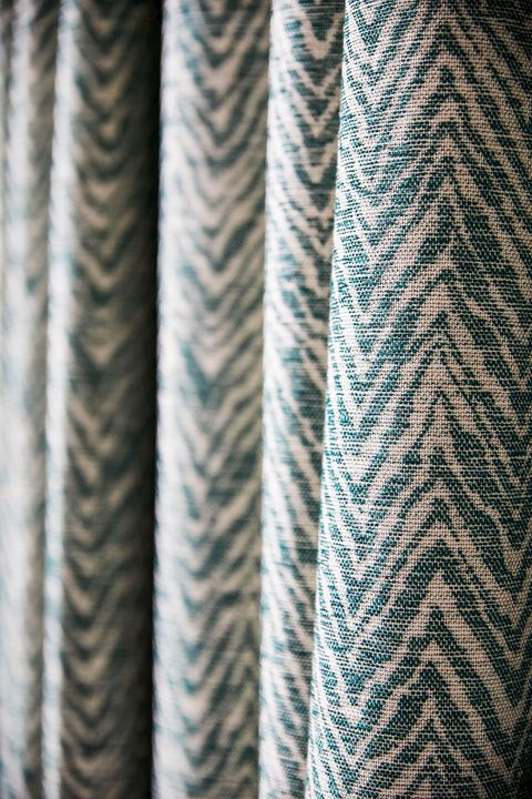 close up of Jagged printed teal and cream curtains