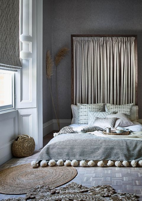Boho bedroom with single window and curtain headboard