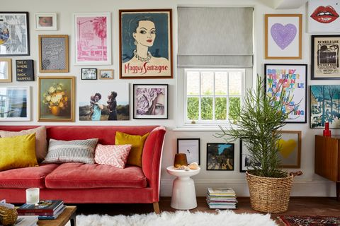 A vibrant gallery wall with a small sash window