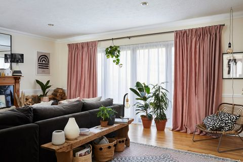 Living room with large sliding doors dressed in voiles and curtains