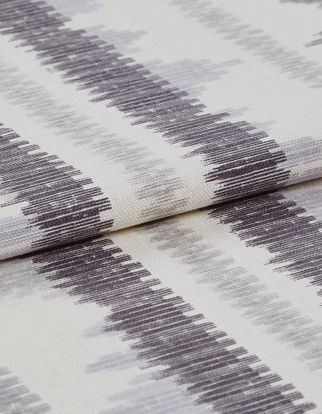 White base colour fabric with black and grey zig zags in repeating pattern across the material