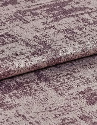 Folded material that is decorated with a shining silver colour and textured purple