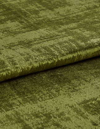 Bright green material matched with darker shades of green in a distressed style