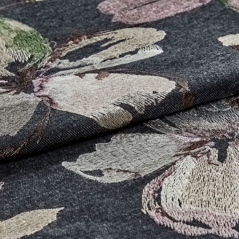 The Forenza Midnight fabric folded, showing a floral design on a black background