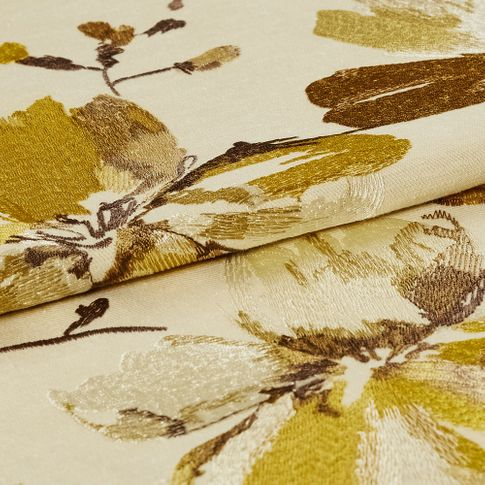 A folded view of the Forenza Sunrise fabric, highlighting its golden floral design