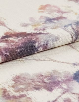 Watercolour style flowers in shades of purple on white base coloured fabric