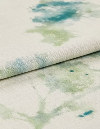 White fabric with floral patterns in a watercolour style