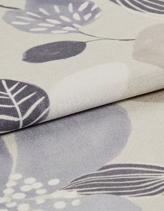 Beige coloured fabric with dark and white styled flowers