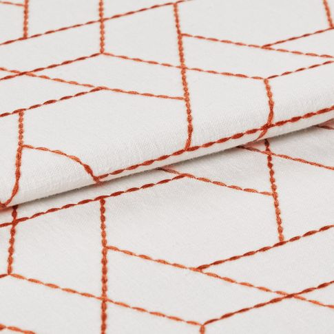 Geometric design outlined in orange on white fabric