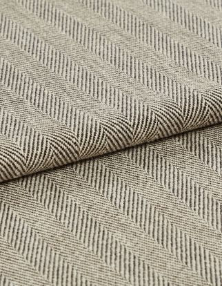 A folded shot of the Kendra Ash fabric, showing its striped, neutral design that is available as a curtain or Roman blind