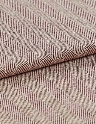 Stripes of red and cream in small diagonal lines that repeat across the fabric