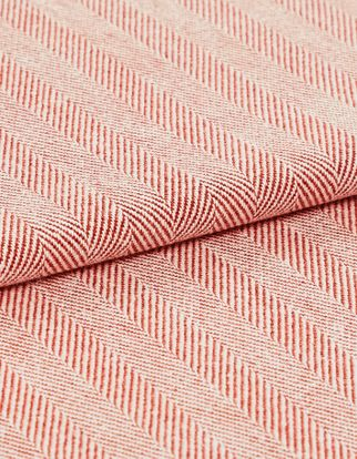 The Kendra Coral Haze fabric folded, showing its lightly toned striped coral design
