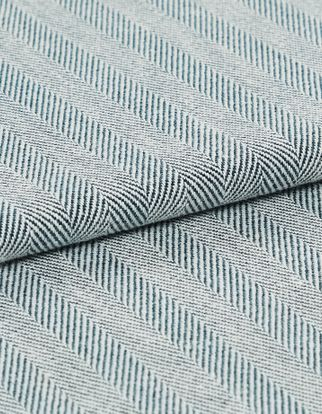 A folded view of the Kendra Navy fabric, which is in a striped blue design